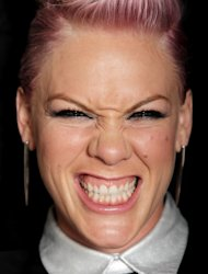 In this Aug. 6, 2012 photo, singer-songwriter Pink poses for a portrait in Santa Monica, Calif. The shortage of turmoil in the life of Pink, who gave birth to daughter Willow last year, doesn't mean she's lacking for something to sing about these days. (Photo by Matt Sayles/Invision/AP)