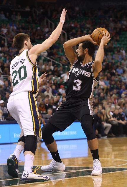San Antonio Spurs' Marco Belinelli (3) looks to pass the ball as Utah Jazz's Gordon Hayward (20) defends in the first half of an NBA basketball game on Saturday, Dec. 14, 2013, in Salt Lake Ci
