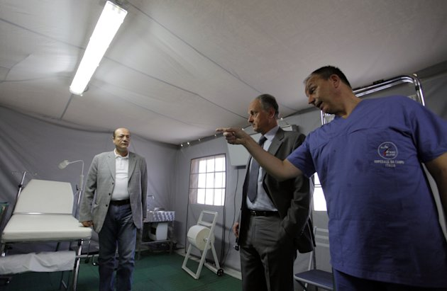 Francesco Fransoni, Italian ambassador to Jordan, center, tours the Italian Field Hospital for Syrian refugees, which was established in al-Mafraq city, Jordan, Tuesday, July 10, 2012. (AP Photo/ Mohammad Hannon)
