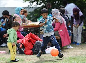 Migrant children play at a temporary camp for asylum-seekers…