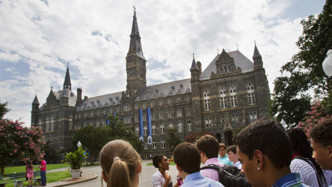 FILE - In this July 10, 2013, file photo, prospective students tour Georgetown University's campus in Washington. The nation's college and university endowments, often used to fund scholarships and professorships, had strong growth in 2013, according to a report released Jan. 28, 2014. That's a bit of good news for higher education institutions under pressure to hold down tuition costs amid some enrollment declines. (AP Photo/Jacquelyn Martin, File)