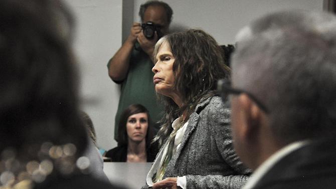 Aerosmith lead singer Steven Tyler listens to testimony on celebrity privacy during a hearing at the Hawaii Capitol in Honolulu on Friday, Feb. 8, 2013. Rock legends StevenTyler and Mick Fleetwood convinced a Hawaii Senate committee on Friday to approve a bill to protect celebrities or anyone else from intrusive paparazzi. The state Senate Judiciary Committee approved the so-called StevenTyler Act after the stars testified. The bill would give people power to sue others who take photos or video of their private lives in an offensive way. (AP Photo/Anita Hofschneider)