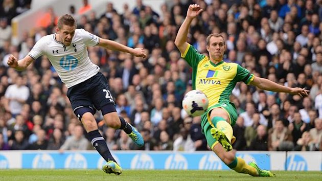 Gylfi Sigurosson of Spurs scores the opening past Steven Whittaker of Norwich City (Getty Images)