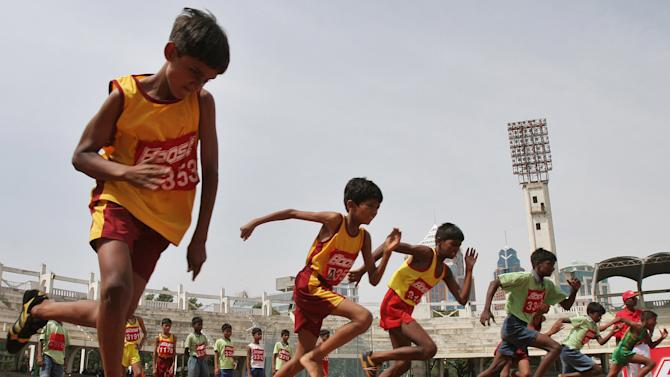 FILE - In this May 13, 2007 file photo, boys participate in 100 meter race during two-day World Athletics Day meet in Bangalore, India. An analysis of studies on 250 million children around the world finds they don't run as fast or as far as their parents did when they were young. Research featured at the American Heart Association's annual conference on Tuesday, Nov. 19, 2013, showed that on average, children 9 to 17 take 90 seconds longer to run a mile than their counterparts did 30 years ago. (AP Photo/Aijaz Rahi, File)