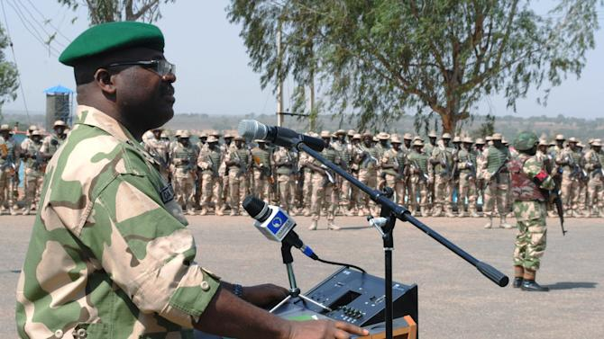 LT. Gen. Onyeabo Azubike Ihejirika, Nigeria chief of Army Staff, addresses Nigeria battalion 1 troops, part of the African led international support mission to Mali, prior to their departure at the peace keeping center in Jaji, Kaduna, Nigeria, Thursday, Jan. 17, 2013. The Federal Government has approved the immediate deployment of 900 troops as part of the ECOWAS  (Economic Community of West African States ) force to push for the emancipation of Northern Mali from the grip of Islamists. (AP Photo)