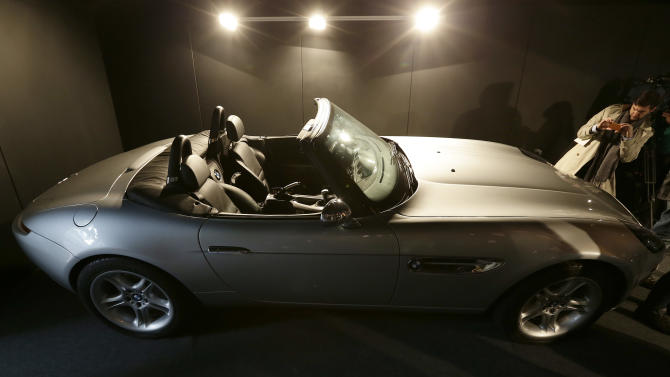 A pre-production replica BMW Z8 roadster made for the film 'The World is Not Enough' starring Pierce Brosnan is seen at a press preview of the James Bond movie memorabilia charity auction at Christie's auction house in London, Friday, Sept. 28, 2012. The car is expected to sell fro some 25-30,000 British pounds ($38-53,000 euro 2-39,000) with the proceeds going to UNICEF.(AP Photo/Alastair Grant)
