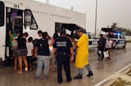 People are evacuated in Quintana Roo State Mexico, August 7 as Hurricane Ernesto made landfall late Tuesday in Mexico's Yucatan peninsula after churning across the Caribbean Sea and drenching the coasts of Honduras and Belize