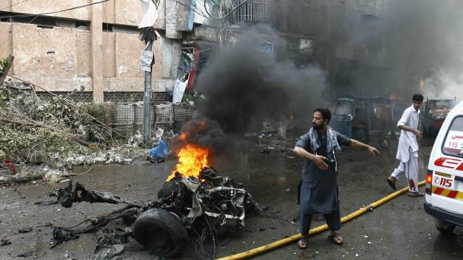 Man calls for help at site of a bomb attack in Peshawar
