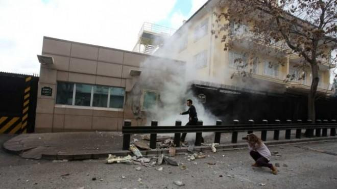 A security officer runs after an explosion at the entrance of the U.S. embassy in Ankara, Turkey, on Feb. 1.