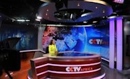 News presenter Beatrice Marshall at CCTV Africa&#39;s studio in Nairobi. CCTV Africa, which employs about sixty people, was the first regional bureau to produce and broadcast its own hour-long news programme on CCTV News