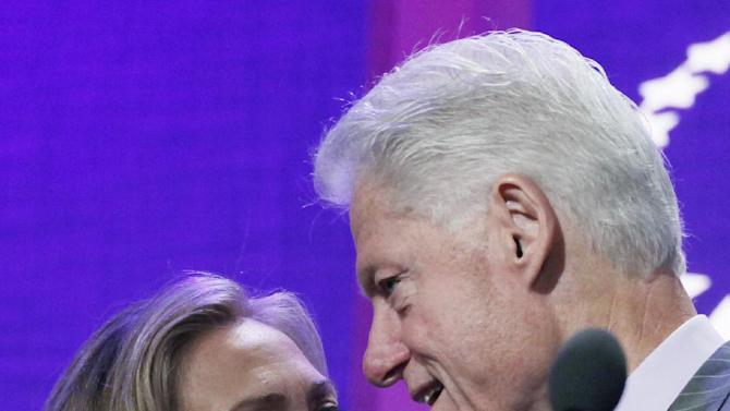 United States Secretary of State Hillary Rodham Clinton is introduced by her husband, former U.S. President Bill Clinton, as she steps to the podium at the Clinton Global Initiative, Monday, Sept. 24, 2012 in New York. (AP Photo/Mark Lennihan)
