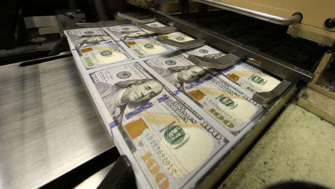New $100 bill has ink well, more color, 3-D