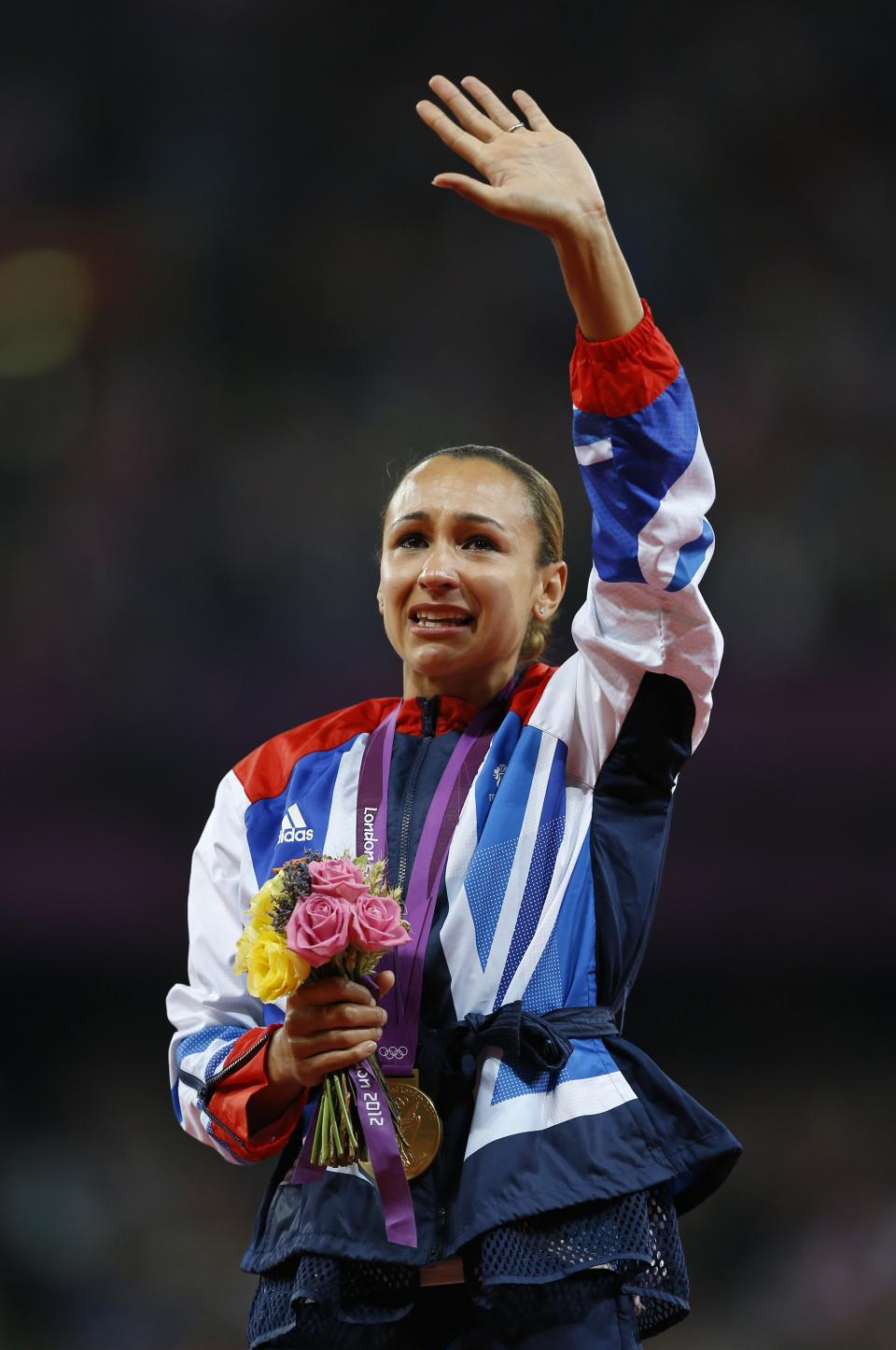 Britain's Jessica Ennis reacts after receiving her gold medal for the heptathlon during the athletics in the Olympic Stadium at the 2012 Summer Olympics, London, Saturday, Aug. 4, 2012. (AP Photo/Daniel Ochoa De Olza)