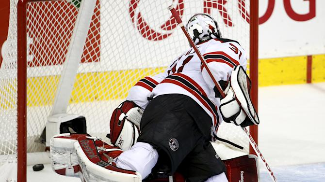 Quebec Remparts goalie Zachary Fucale concedes a goal to Rimouski Oceanics Justin Samson during the first period of their Memorial Cup hockey game at the Colisee Pepsi in Quebec City