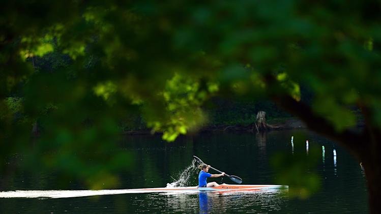 Jenny Payne paddles along the Mississippi River in Carleton Place, Ontario, on Thursday, July 24, 2014. (AP Photo/The Canadian Press, Sean Kilpatrick)