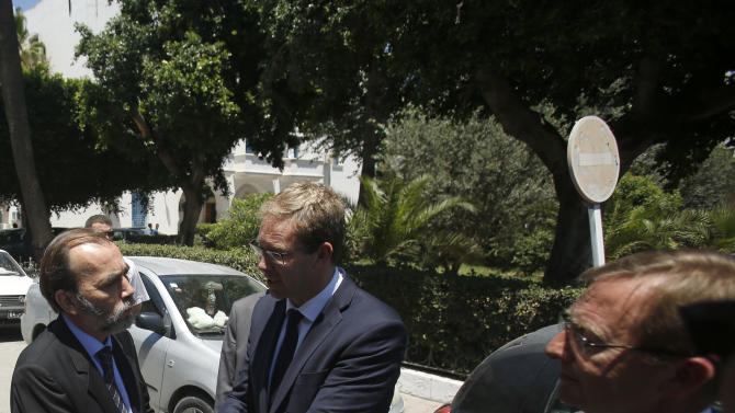 Tunisia's health minister Said Aidi, left, shakes hands with British Minister for North Africa Tobias Ellwood in a local hospital in Tunis, Tunisia, Tuesday, June 30, 2015. Thirty-eight tourists died in a gun attack just days before Tunisia planned to implement heightened security measures for the Muslim fasting month of Ramadan, but those plans had not anticipated an assault on tourist beaches, the country's president said Tuesday. (AP Photo/Darko Vojinovic)