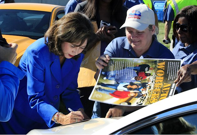 U.S. Secretary of Labor Hilda Solis signs autographs outside the Flat Rock Assembly in Flat Rock, Mich., Monday, Sept. 10, 2012. The plant, formerly known as AutoAlliance International will continue t
