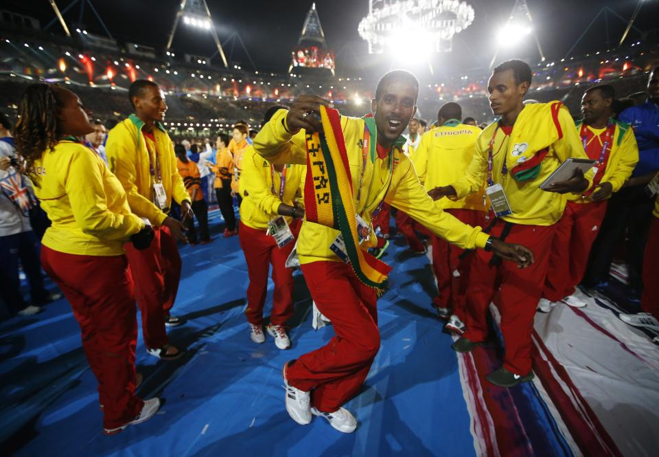 Ethiopian athletes dance during the Closing Ceremony at the 2012 Summer Olympics, Sunday, Aug. 12, 2012, in London. (AP Photo/Jae C. Hong)