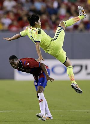 Japan scores late to pull away from Costa Rica 3-1