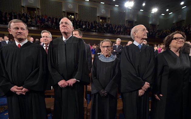 From left, Chief Justice John G. Roberts and Supreme Court justices Anthony M. Kennedy, Ruth Bader Ginsburg, Stephen G. Breyer and Sonia Sotomayor sta...