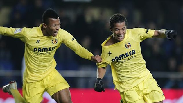 Villarreal's Mexican forward Giovani Dos Santos (R) celebrates after scoring against Real Sociedad (AFP)