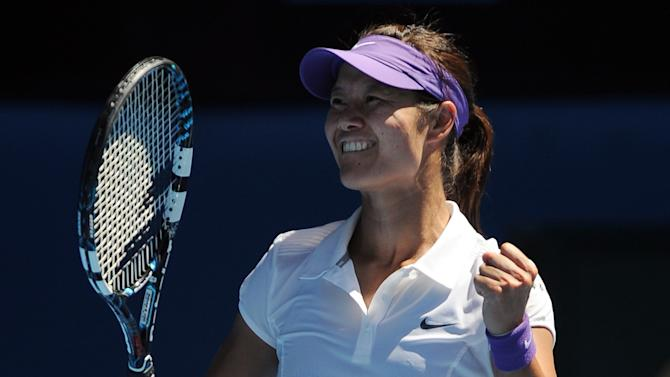 China's Li Na celebrates after defeating Russia's Maria Sharapova in their semifinal match at the Australian Open tennis championship in Melbourne, Australia, Thursday, Jan. 24, 2013. (AP Photo/Andrew Brownbill)