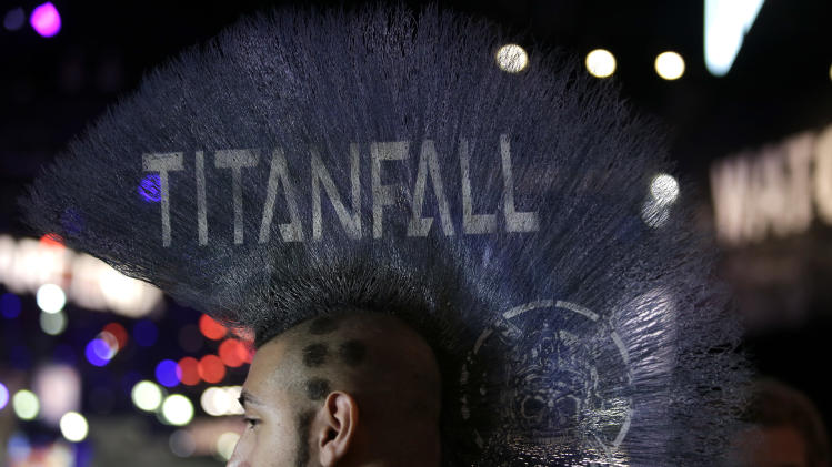 "Ryan Hakik sports a Mohawk hairdo with the title of the video game ""Titanfall"" printed on it during the Electronic Entertainment Expo in Los Angeles, Wednesday, June 12, 2013. (AP Photo/Jae C. Hong)"