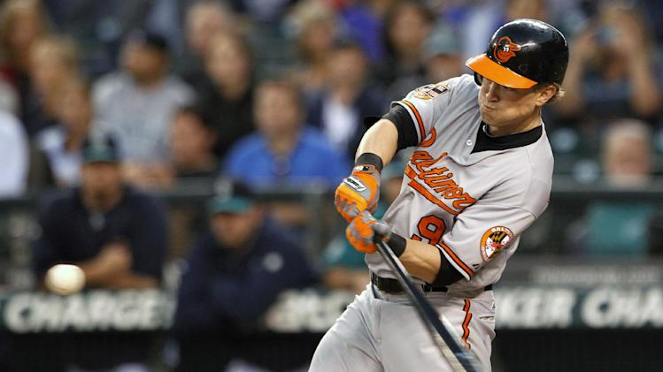 Baltimore Orioles' Nate McLouth homers against the Seattle Mariners in the first inning of a baseball game, Monday, Sept. 17, 2012, in Seattle. (AP Photo/Elaine Thompson)
