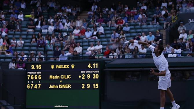 Marin Cilic of Croatia serves to John Isner of the United States, during their singles match,  at the All England Lawn Tennis Championships in Wimbledon, London, Friday July 3, 2015. (AP Photo/Pavel Golovkin)