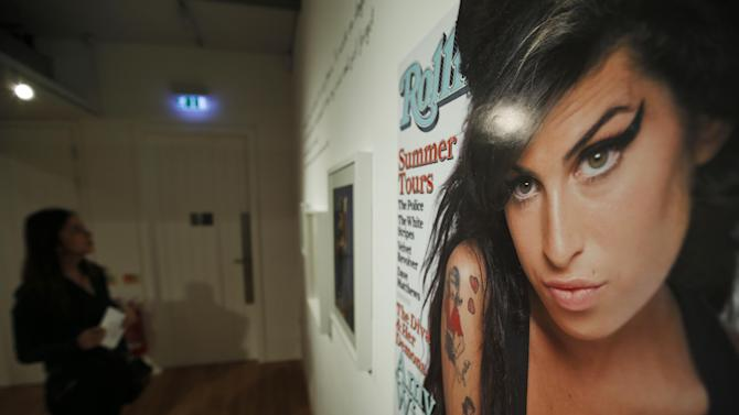 """An exhibition entitled """"Amy Winehouse: A Family Portrait"""" in London's Jewish Museum, Tuesday, July 2, 2013. The exhibition aims to reveal an intimate side of the late soul diva. She was, in the words of her older brother Alex, """"simply a little Jewish kid from North London with a big talent."""" It includes a trove of items from the singer's London childhood, her stage-school years and her short but stratospheric career in music _ from her first guitar to a posthumous Grammy Award. By the time she died in 2011 at the age of 27, Winehouse was a star, a larger-than-life figure whose battles with drugs and alcohol, splashed across front pages around world, sometimes seemed to overshadow her talent. (AP Photo/Lefteris Pitarakis)"""