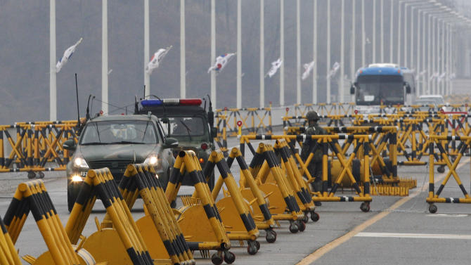 South Korean army vehicles cross Unification Bridge in Paju, South Korea, near the border village of Panmunjom, Saturday, April 6, 2013. More South Koreans on Saturday began to leave North Korea and the factory park where they work, four days after Pyongyang closed the border to people and goods. (AP Photo/AhnnYoung-joon)