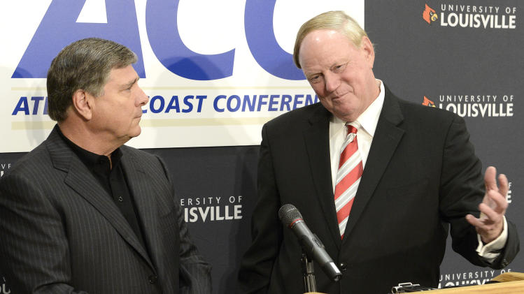 University of Louisville President Dr. James Ramsay, right, and Louisville Athletic Director Tom Jurich field questions during a news conference, Wednesday, Nov. 28, 2012, in Louisville, Ky., announcing that the university is joining the Atlantic Coast Conference. (AP Photo/Timothy D. Easley)