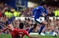 Everton's midfielder Marouane Fellaini (R) clashes with Southampton's defender Maya Yoshida during their English Premier League football match at Goodison Park in Liverpool, north-west England. Everton won 3-1