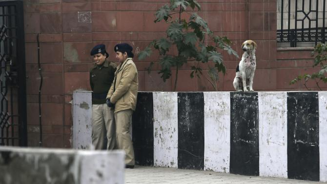 Indian female police officers stand guard outside the district court where five men accused in a gang rape were brought to appear in New Delhi, India, Monday, Jan. 7, 2013. The men, who were set to appear in court Monday, are accused of the Dec. 16 gang rape on a woman, who later died of her injuries, that has caused outrage across India, sparking protests and demands for tough new rape laws. (AP Photo/Manish Swarup)