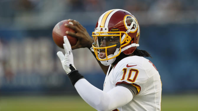FILE - This Aug. 18, 2012 file photo shows Washington Redskins rookie quarterback Robert Griffin III warming up before an NFL preseason football game against the Chicago Bears in Chicago. Youth and inexperience have taken over the most important position in the NFL. Ten starting quarterbacks will have one year or less of experience this season, with five teams letting rookies run the show.  (AP Photo/Charles Rex Arbogast, File)