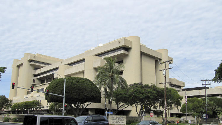 Cars pass in front of the federal building housing U.S. District Court in Honolulu on Friday, March 7, 2014. A courtroom in this building is set to become the scene of a death penalty trial even though Hawaii abolished capital punishment in 1957. (AP Photo/Jennifer Sinco Kelleher)