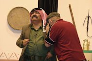 Image provided by Amman&#39;s Concorde Theatre shows Jordanian comedian Musa Hijazin (L) in the role of Abu Saqer in the satirical play &quot;Now, I understand You&quot; in Septemer 2011. Every week, Jordanians pack the Concorde theatre to laugh at the shortcomings of their government and regional politicians still resisting the Arab Spring