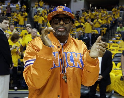 Spike Lee claps before the start of Game 6 of an Eastern Conference semifinal NBA basketball playoff series between the Indiana Pacers and the New York Knicks Saturday, May 18, 2013, in Indianapolis