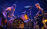 The Black Keys guitarist Dan Auerbach looks over at drummer Patrick Carney as they play on the main stage at the Coachella Valley Music & Arts Festival in Indio