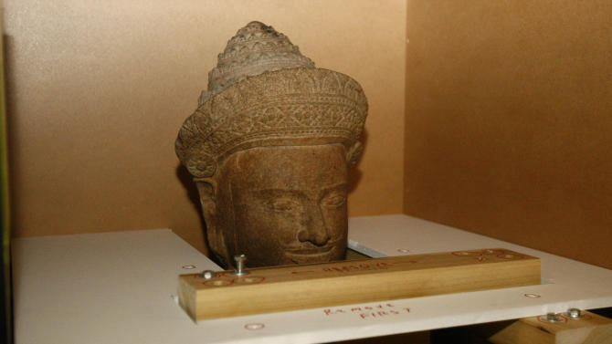 The 10th-century Cambodian sandstone statue from the Metropolitan Museum of Art in New York is seen in a box during a handover ceremony, at Phnom Penh International Airport,  Phnom Penh, Cambodia, Tuesday, June 11, 2013. Two 10th century Cambodian stone statues displayed for nearly two decades at New York's Metropolitan Museum of Art were returned to their homeland Tuesday in a high-profile case of allegedly looted artifacts. (AP Photo/Heng Sinith)