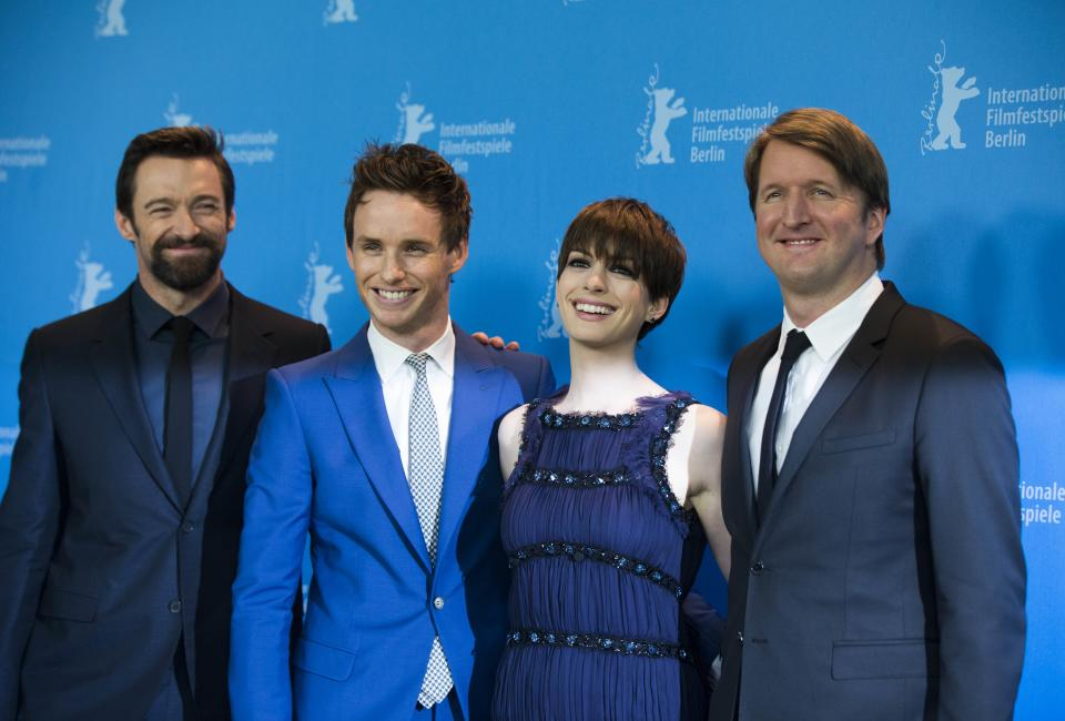 From left, actor Hugh Jackman, actor Eddie Redmayne, actress Anne Hathaway and director Tom Hooper pose at the photo call of the film Les Miserables at the 63rd edition of the Berlinale, International Film Festival in Berlin, Germany, Saturday, Feb. 9, 2013. (AP Photo/Gero Breloer)
