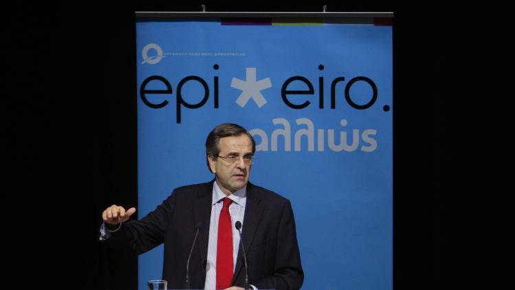 "Greek Prime Minister Antonis Samaras speaks at a business presentation organized by the youth wing of his center-right New Democracy party, in Athens, Tuesday, Nov. 20, 2012. Samaras described EU negotiations in Brussels Tuesday to try and address Greek debt sustainability as ""incredibly difficult."" (AP Photo/Petros Giannakouris)"