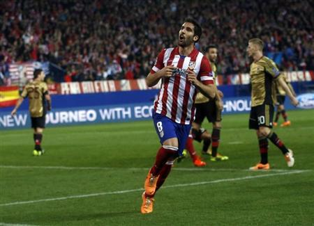 Atletico Madrid's Raul Garcia celebrates scoring a goal against AC Milan during their Champions League last 16 second leg soccer match at Vicente Calderon stadium in Madrid