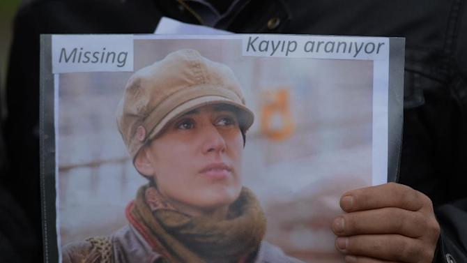 A member of the Istanbul-based Association For Families With Lost Relatives hands out flyers with photos of Sarai Sierra, a New York City woman who disappeared while on vacation in Istanbul, urging anyone with information to call police, in Istanbul, Turkey, Thursday, Jan. 31, 2013. Sierra, a 33 year-old mother of two, has been missing since Jan. 21, when she was due to return home. Turkish police have set up a special unit to search for her and are trying to trace a man she had been in contact with during her stay.(AP Photo)