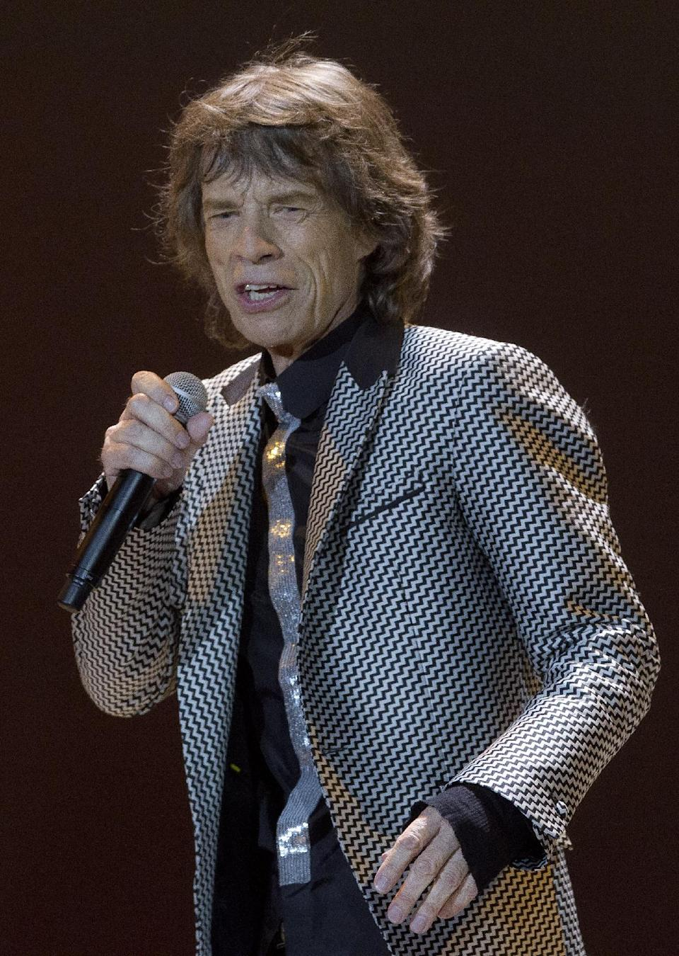 Mick Jagger of The Rolling Stones performs at the O2 arena in east London, Sunday, Nov. 25, 2012. The band are playing four gigs to celebrate their 50th anniversary, including two shows at London's O2 and two more in New York. (Photo by Joel Ryan/Invision/AP)