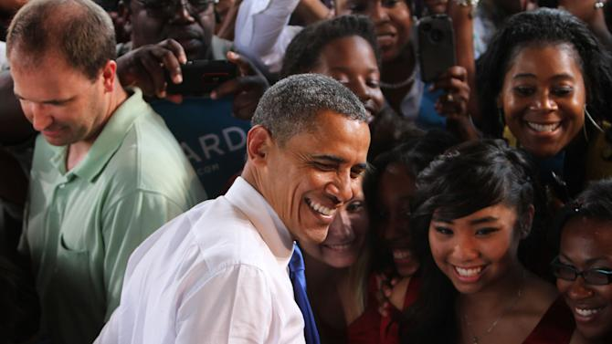 Following his campaign speech at Farm Bureau Live in Virginia Beach,Va., President Barak Obama greets and takes photos with supporters along the rope-line Thursday, Sept. 27, 2012, afternoon.(AP Photo/The Virginian-Pilot,Stephen N. Katz )  MAGS OUT