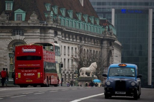 <p>A taxi drives through central London on October 23, 2012. Britain is expected to confirm Thursday that its longest double-dip recession since the 1950s is over, but the return to growth remains clouded by fears about the economy's underlying health.</p>