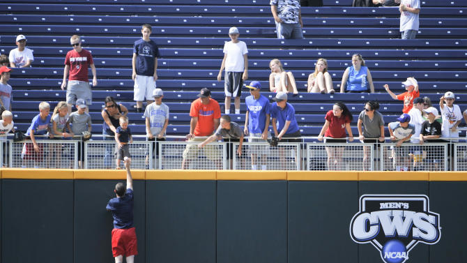 An unidentified Stony Brook player makes sure a young fan gets a ball during baseball practice at TD Ameritrade Park in Omaha, Neb., Thursday, June 14, 2012. Stony Brook will play against UCLA on Friday in the opening game of the NCAA baseball College World Series. (AP Photo/Eric Francis)