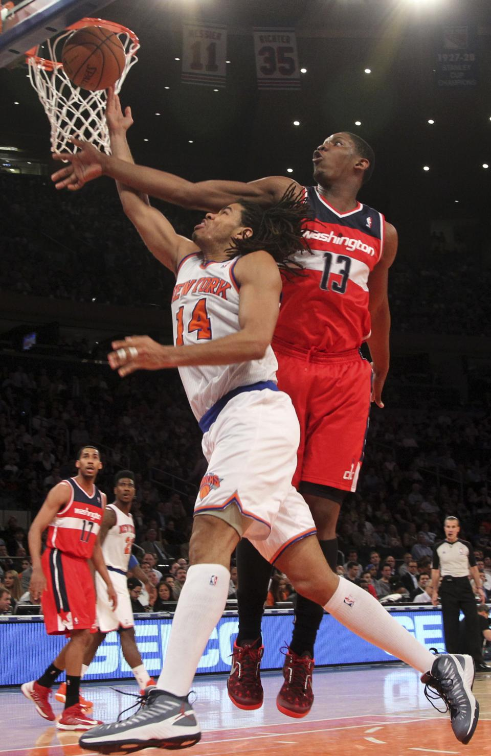 Washington Wizards' Kevin Seraphin (13) blocks New York Knicks' Chris Copeland from going to the basket during the second half of an NBA basketball game, Tuesday, April 9, 2013, at Madison Square Garden in New York. The Knicks won 120-99. (AP Photo/Mary Altaffer)