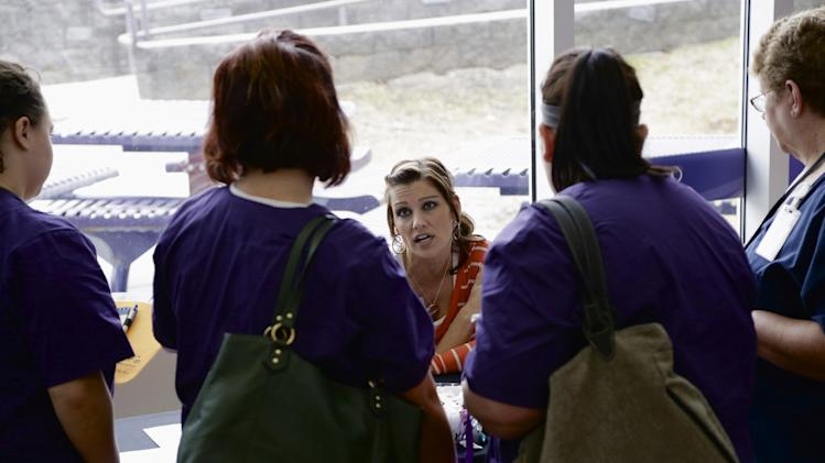 In this April 10, 2014 photo, Jennifer Stickney, a recruiter for Right at Home, which provides in-home care and assistance, answers questions from nursing students at a job fair on the campus of Kaplan University in Lincoln, Neb. The Labor Department on Friday, May 2, 2014 said U.S. employers added a robust 288,000 jobs in April, the most in two years, the strongest evidence to date that the economy is picking up after a brutal winter slowed growth. (AP Photo/Nati Harnik)